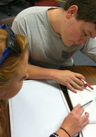 Academic success center tutor helping a student